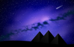 Shooting star over purple mountain