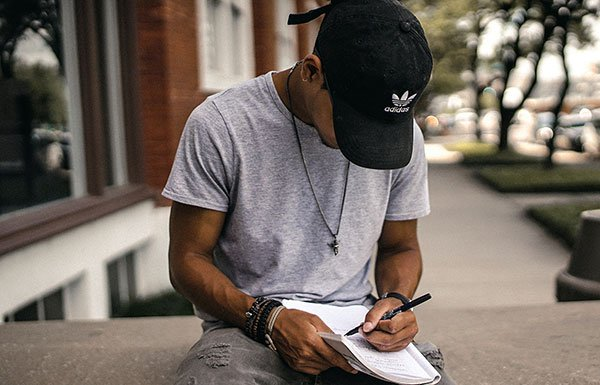 Reporter writing in a notebook