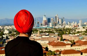 Man in turban looking at North American city