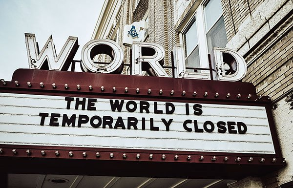 """Marquee with """"The World is Temporarily Closed"""" written on it"""