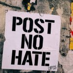 """Wall with poster that says """"Post No Hate"""""""
