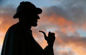 Sherlock Holmes statue against sunset