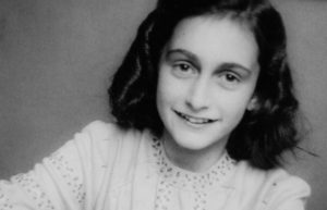 Black and white photo of author Anne Frank