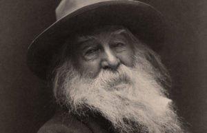 Portrait of Walt Whitman in a floppy hat with a white beard