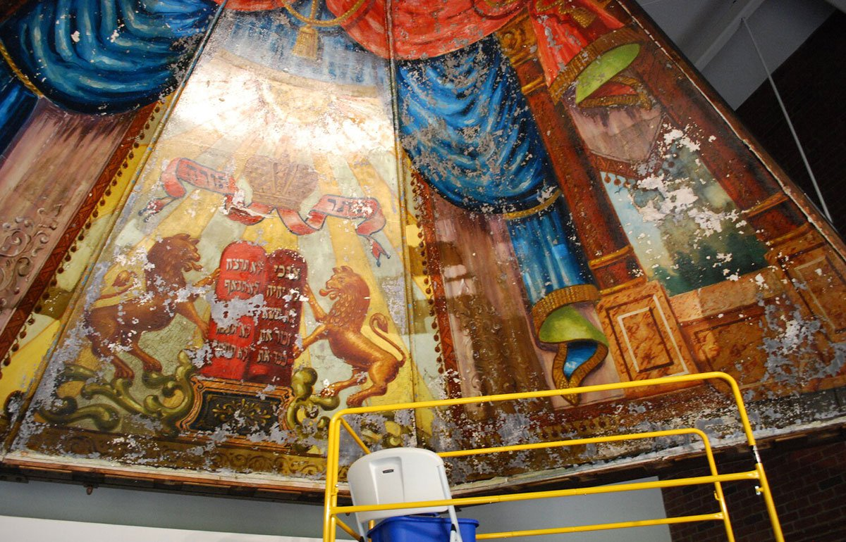 Construction staging in front of colorful Lost Mural painting