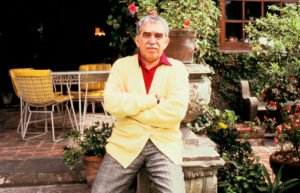 Author Gabriel Garcia Marquez sitting outside with his arms crossed