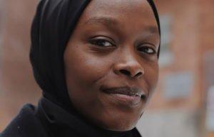 Young Black Muslim woman in a black head scarf