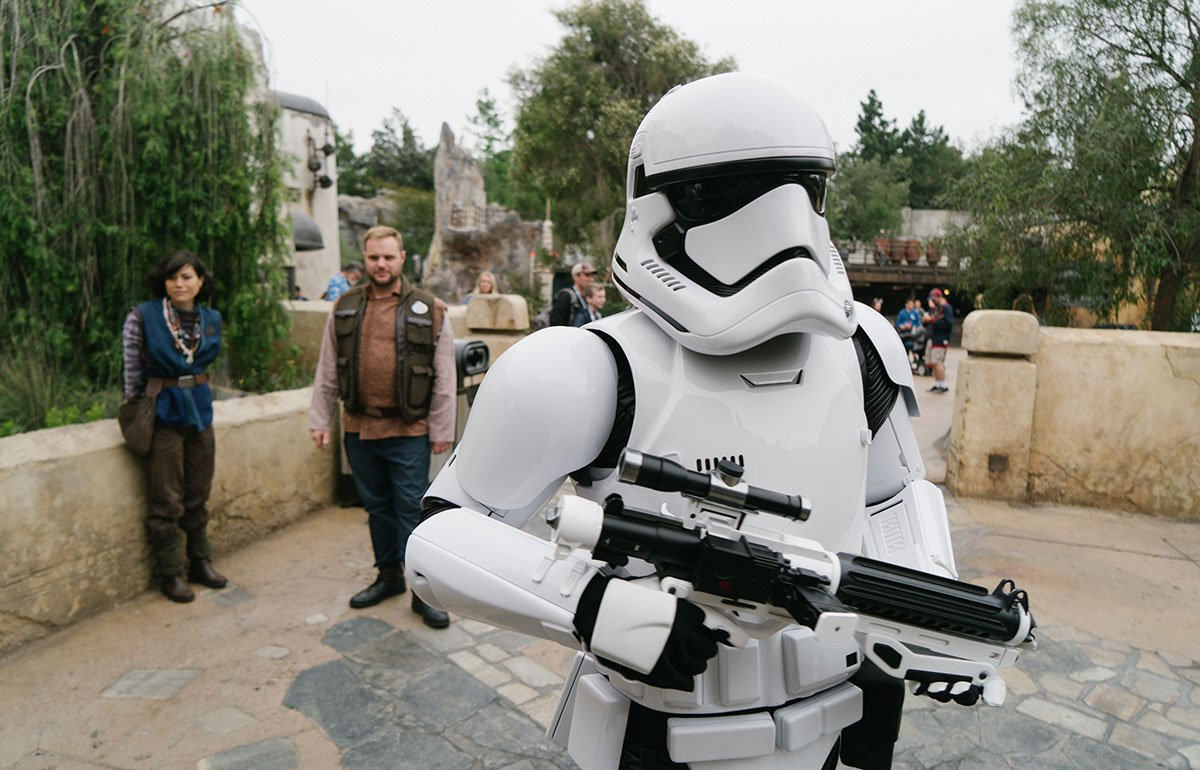 Person in white Star Wars stormtrooper costume, with another costumed person looking on