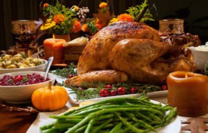 Thanksgiving turkey on table with other traditional holiday foods