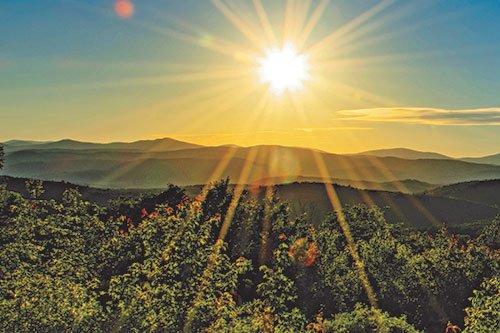 Sun rising over the Green Mountains