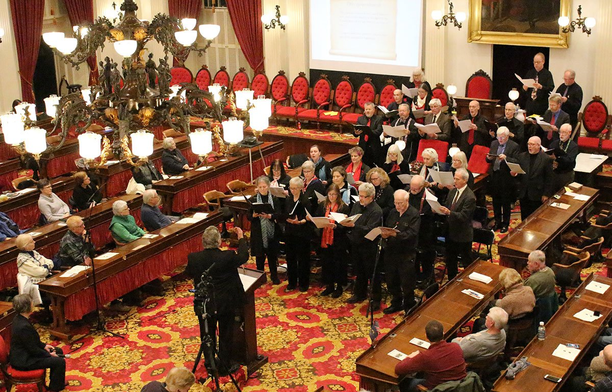 Choral group singing inside the Vermont State House
