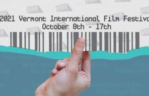 Hand holding ticket to Vermont International Film Festival